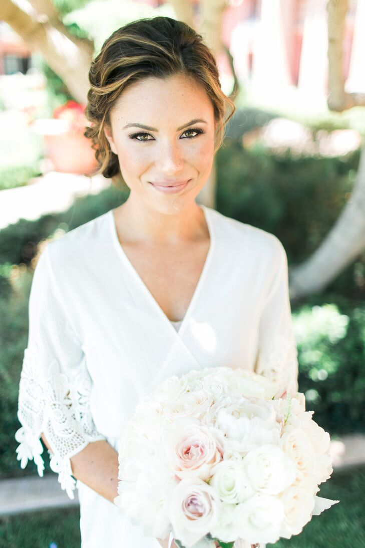 Bree wore an embroidered ivory dressing robe as she and her bridesmaids were prepped with hair and makeup artists from Oceanside's Big Day Hair and Makeup. Her hair—a low, loose bun twisted together at the nape of her neck—reflected the day's polished, romantic feel.