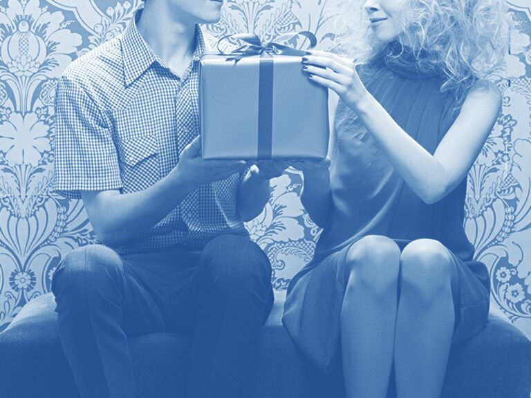 couple exchanging a gift