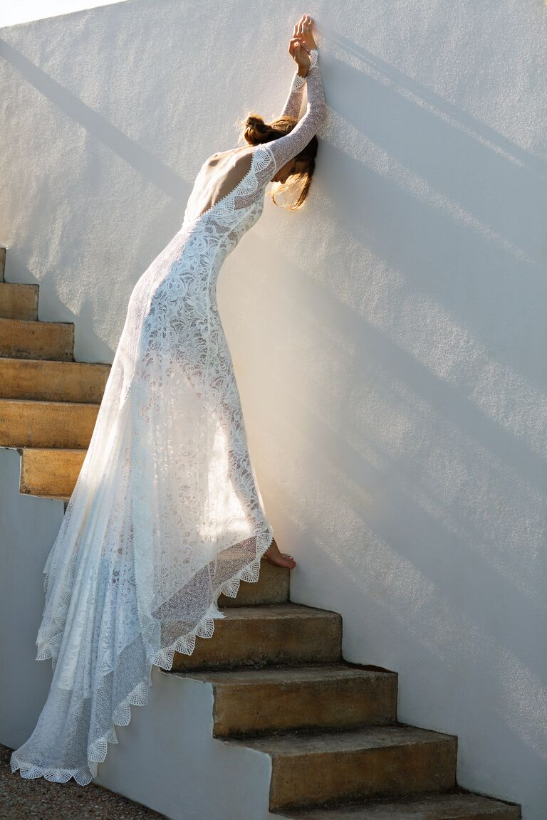 Grace Loves Lace Elixir Collection wedding gown with layered lace patterns and long train