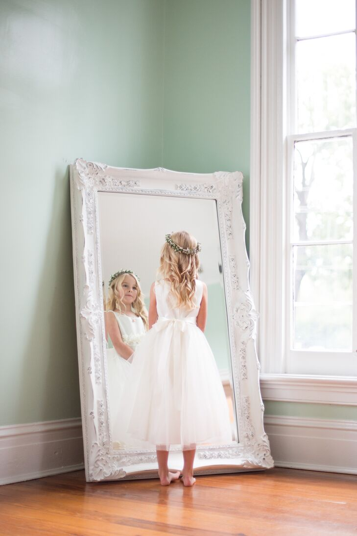 Miriam and Gordon's flower girl wore an ivory dress with a sweet tulle skirt. For an angelic look, a simple flower crown of baby's breath adorned her hair.