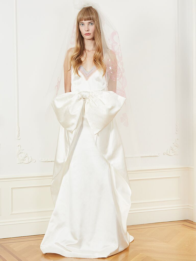 Honor A-line wedding dress with V-neckline and bow detail.