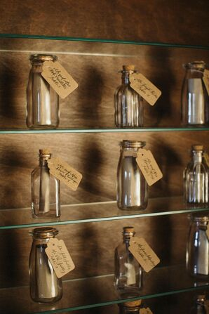 Eclectic Escort Cards with Glass Bottles and Calligraphed Tags