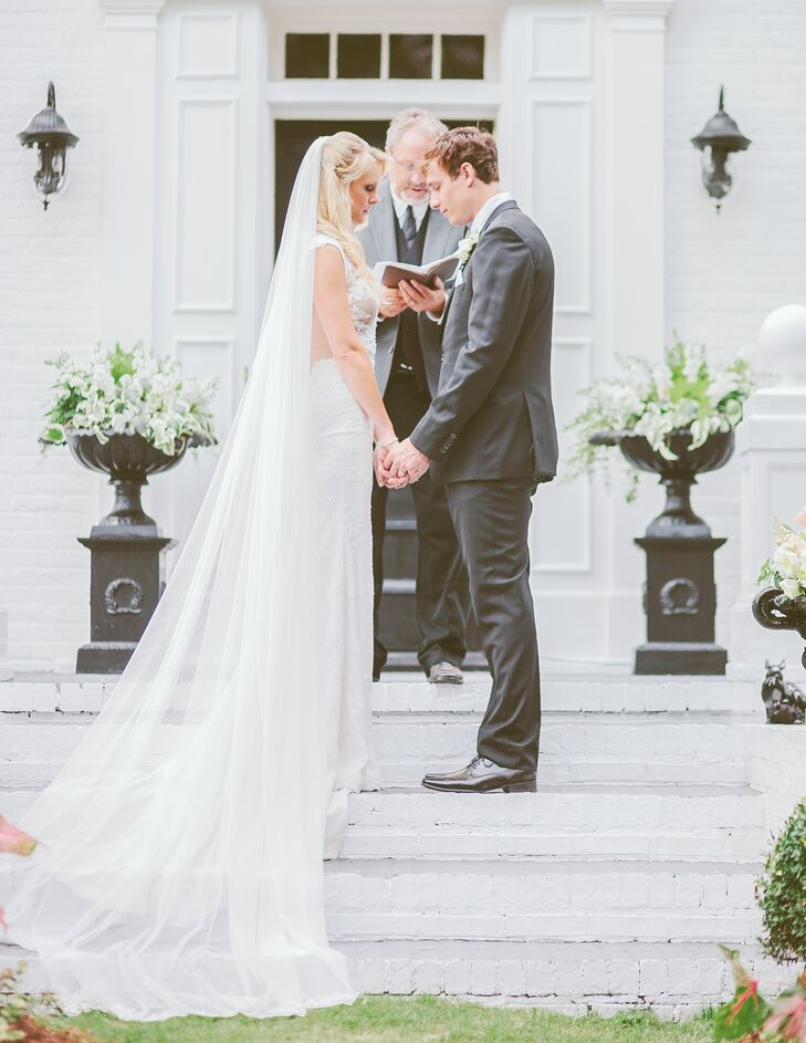 """We had our ceremony in front of the original home that dates back to the 1800s,"" says Jessie. ""We had beautiful blush and light peach flowers all around and a harp player on the porch of the main mansion."""