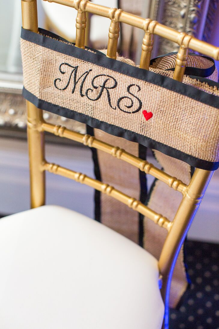 Burlap and mason jars were popular throughout the couple's decor. Burlap and navy ribbon-lined signs decorated Miriam and Mark's seats at the reception. The remaining family-style tables were met with burlap runners and painted mason-jar table numbers.