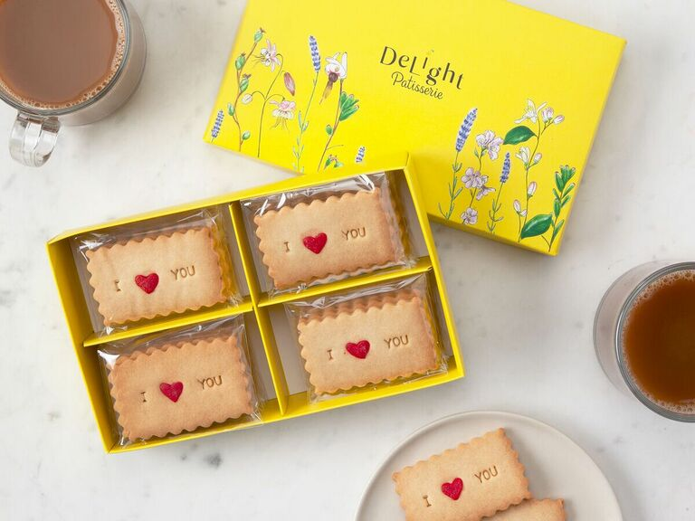 Decorative yellow box with shortbread cookies that read I Heart You
