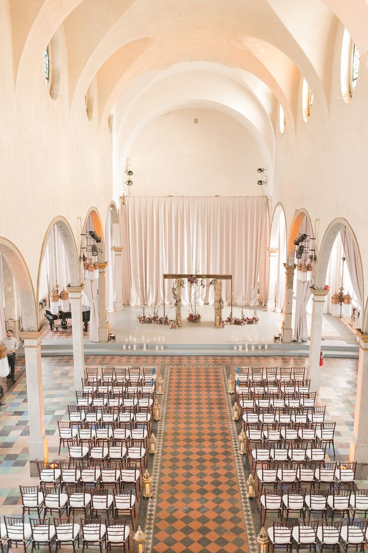 """Our ceremony was at the Marigny Opera House, an absolutely amazing space that exudes old elegance. It's located in the Marigny neighborhood of New Orleans. We chose this venue because it's original, and we were able to customize the entire look and feel of our event in this stunning space,"" Beth says."