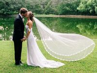 bride and groom kissing outdoor wedding portraits