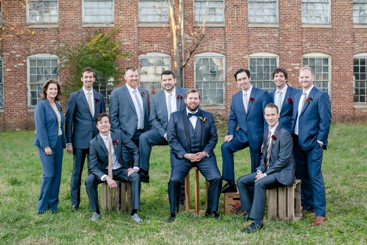 """Groomsmen sported mismatched slim-fit suits in light blue-gray, herringbone and bright blue with skinny ties in various metallic shades. """"These gents looked smashing,"""" Maggie says. Nan, one of Doug's attendants, donned a matching blue suit with a gold sweater and necklace (to match the bridesmaids)."""