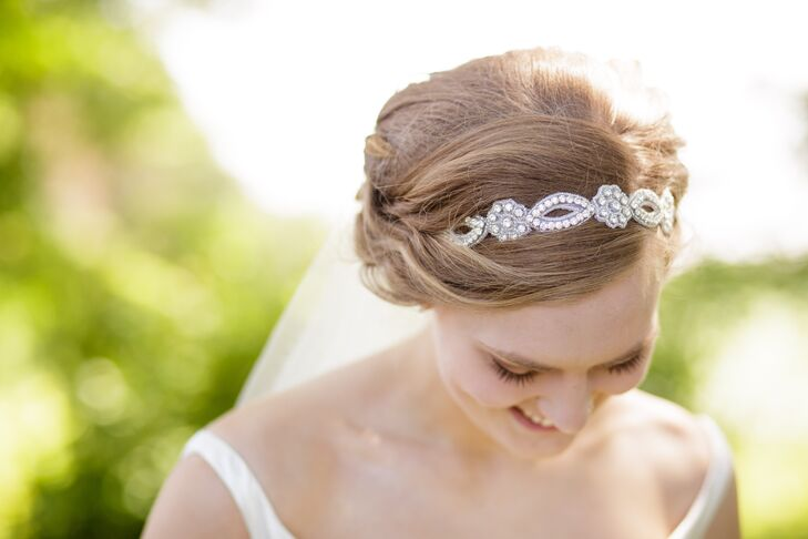 Woven into Bridget's updo hairstyle was an elegant floral headband, which had a beaded crystal pattern throughout.