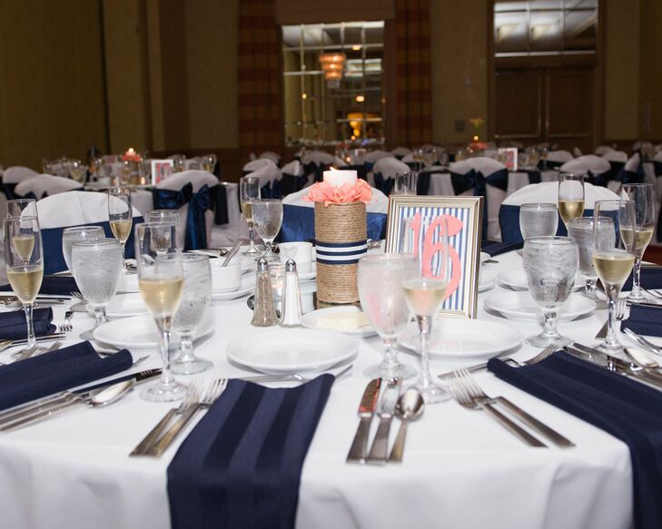 Stacked rope candle holders and preppy framed table numbers added height to the brides DIY seaside tablescapes.