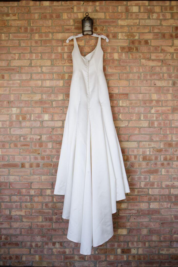 """""""The dress I found hugged by curves, but kept me looking classy,"""" Bridget says. """"It had a beautiful train that swept along behind me. My dress had no beading or decoration on it, which allowed the gorgeous heavy ivory satin it was made out of to shine."""""""