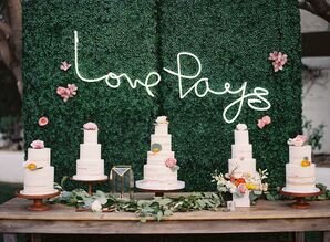 Bohemian Cake Table with Flower Wall and Neon Sign