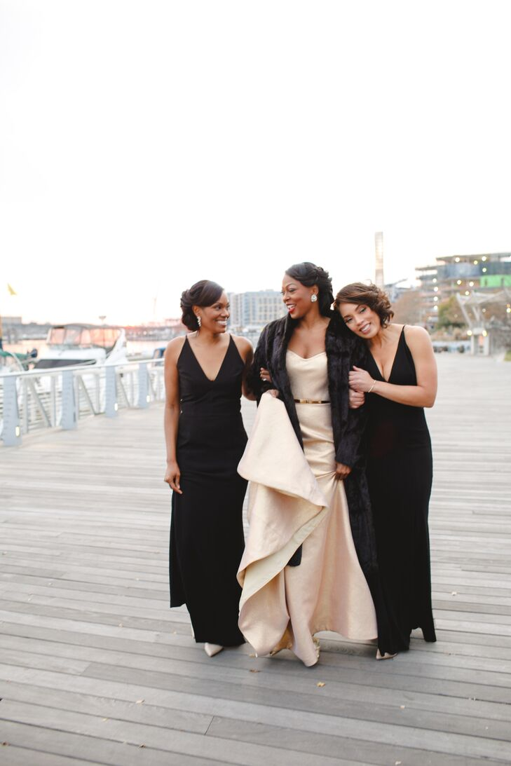 Bride in Champagne Gown with Fur Stole and Bridesmaids in Black Gowns