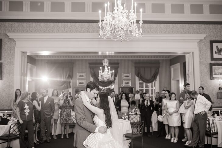 Elon and Justin had their first dance in front of all their friends and family inside the New Albany Country Club in New Albany, Ohio. As the couple danced underneath the elegant hanging chandelier, Elon's traditional ivory tulle veil swayed from side to side, which was designed by Justine M Couture from Ivy Bridal Studio.