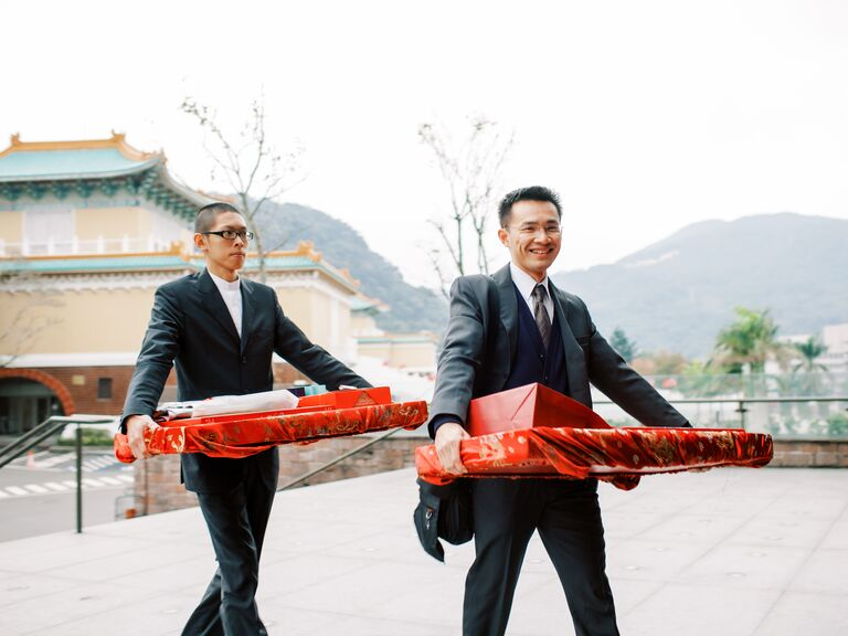 Six gifts being carried into Chinese wedding ceremony