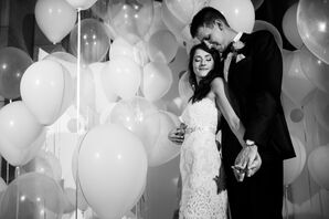 Married Couple Surrounded By Balloons