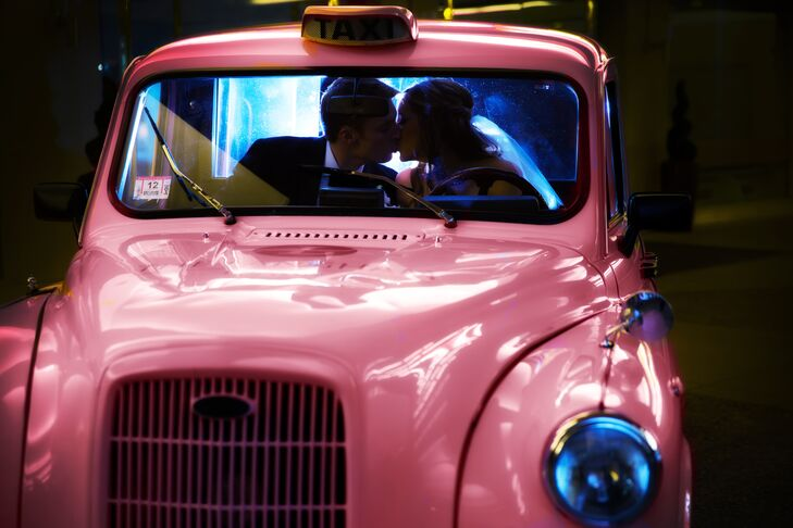 The couple shared a kiss inside a vintage pink taxi cab.