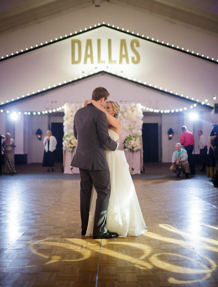 """Blair and Alex shared their first dance to """"Two Is Better Than One"""" by Boys Like Girls. Beside them, their custom monogram in gold lights shone onto the dance floor."""