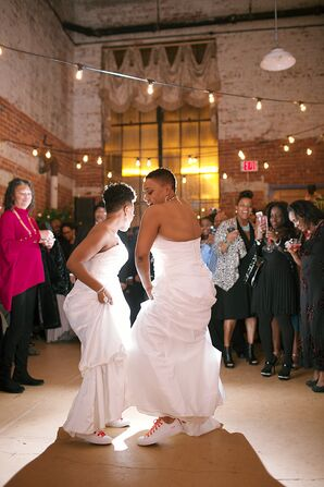 Brides Dancing in Converses Under String Lights