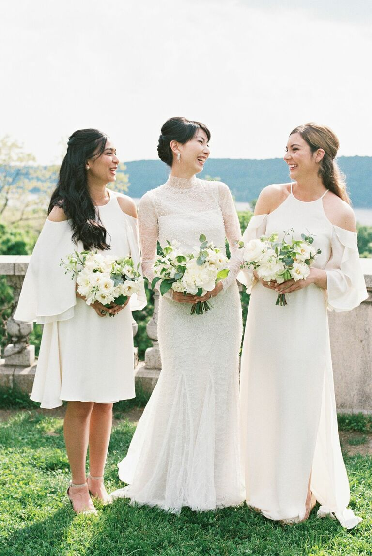 Bride with two bridesmaids in white dresses
