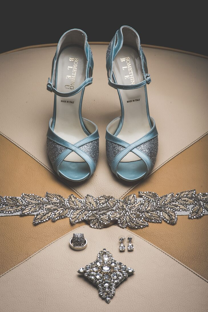 Rebecca wore blue open-toed shoes and a crystal accented belt by BHLDN, along with silver jewelry pieces and a hair pin.