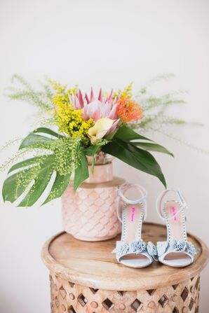 Blue Shoes and Bouquet with Protea and Monstera Leaves