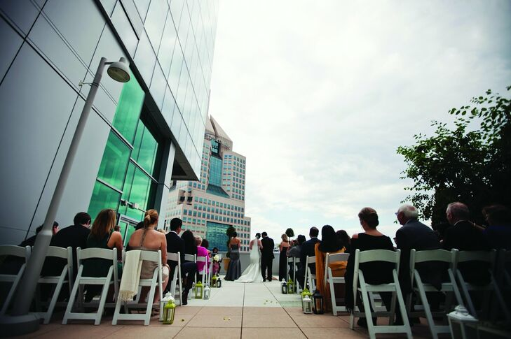 The couple wed on a terrace overlooking the city skyline.