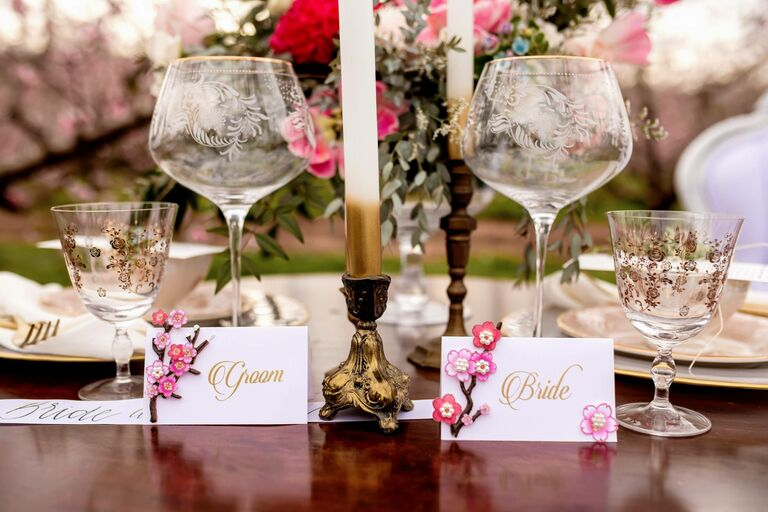 Glasses at bride and groom's sweetheart table