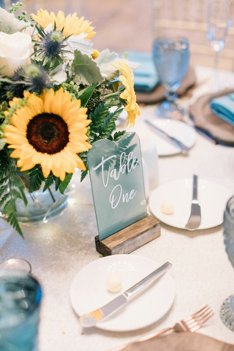 Sunflower centerpiece and blue seagrass table number
