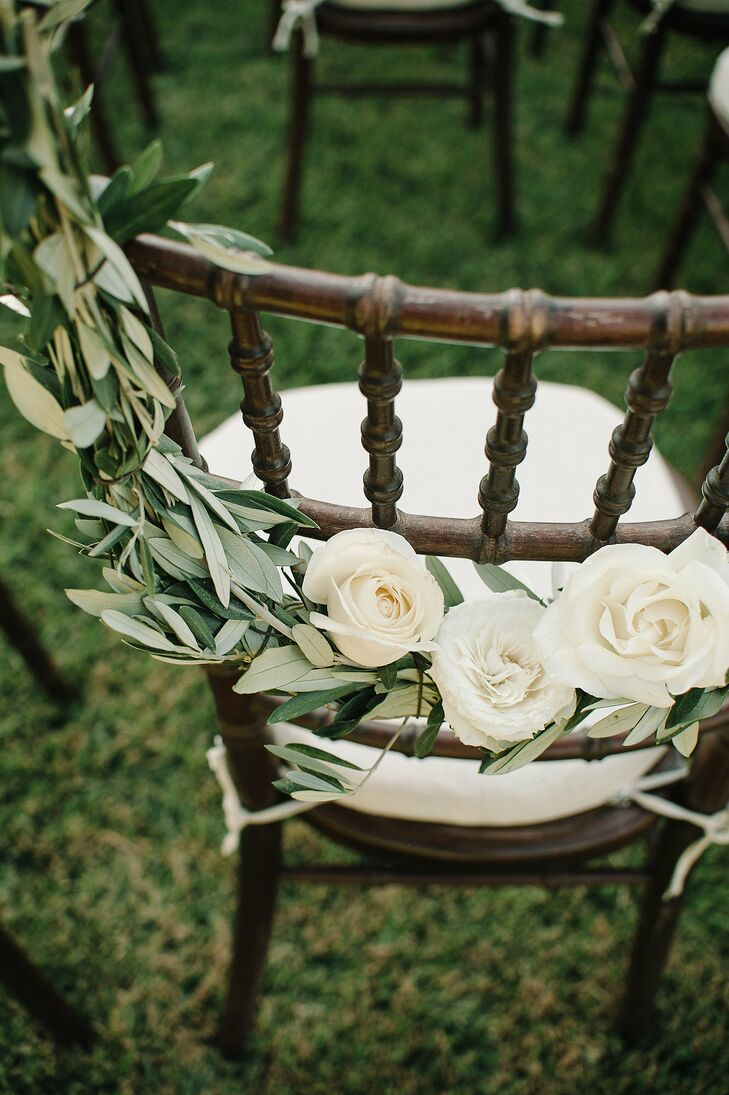 The chiavari chairs were decorated with olive branches and rose garlands, serving as a nod to the rose garden setting and the Beldi's surrounding olive groves.