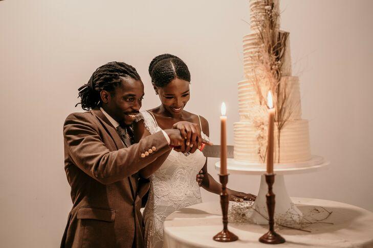Couple Cutting Cake During Wedding in Durham, North Carolina