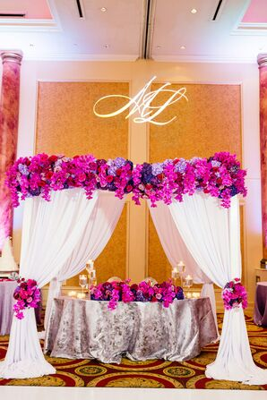 Elegant Sweetheart Table With Draping, Monogram and Bold Florals
