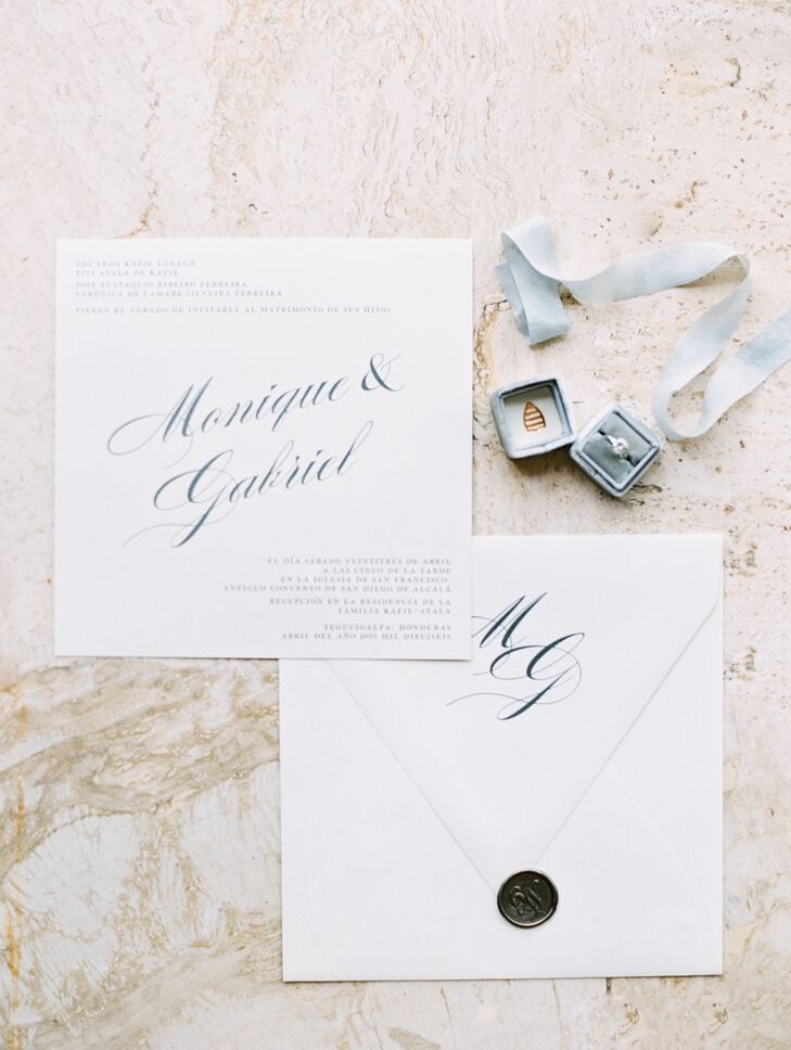 Monique and Gabriel's invitation suite echoed their classic-meets-modern theme and centered on large, elegant blue calligraphy.
