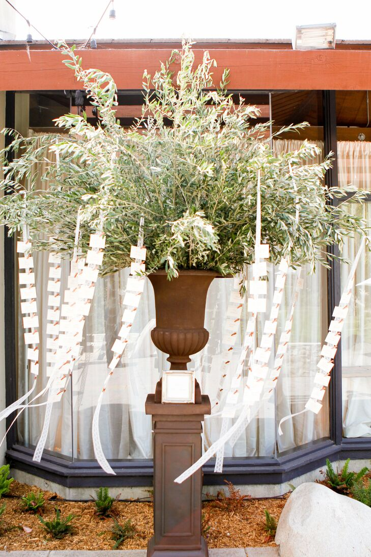 Escort cards were draped in garlands hanging from an impressive floral arrangements.