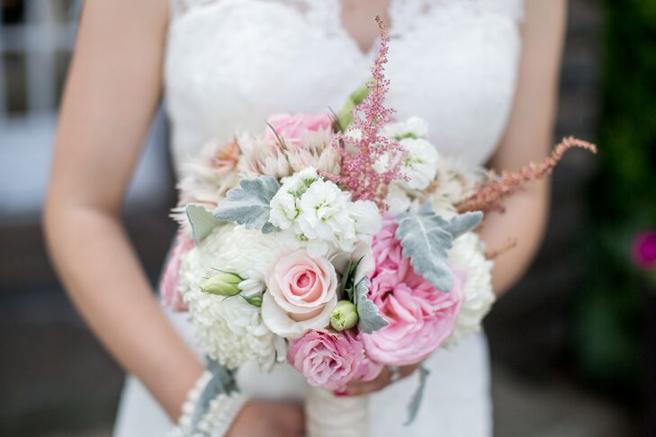 Sarah carried a soft, romantic bouquet filled with white hydrangeas, pink roses, astilbes, and dusty miller.