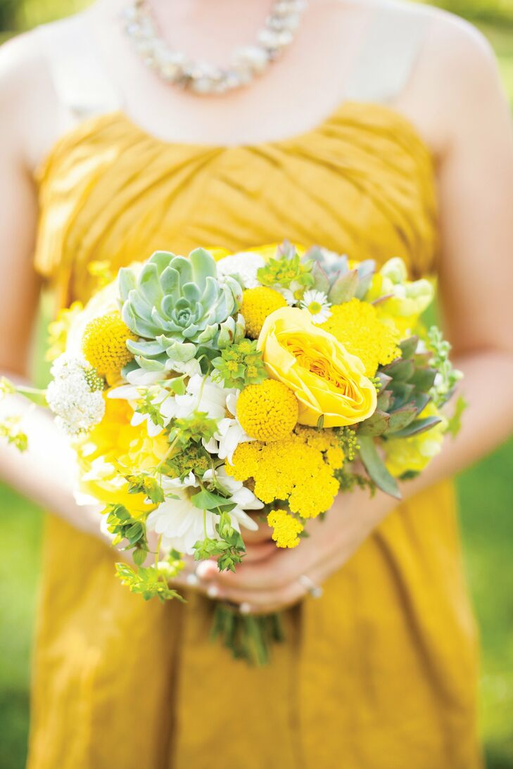 The girls carried yellow-and-white bunches of daisies, yarrow, craspedia, asters, cosmos and succulents.