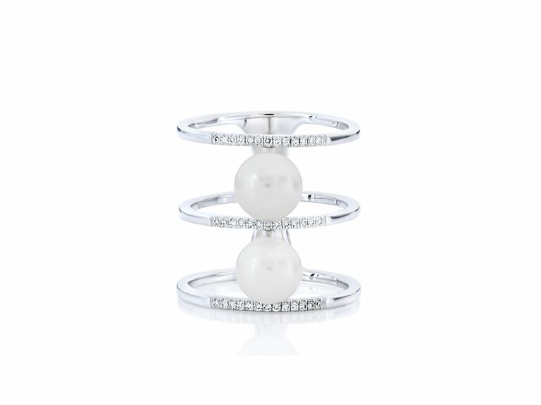 pearl two stone ring with white metal cage setting