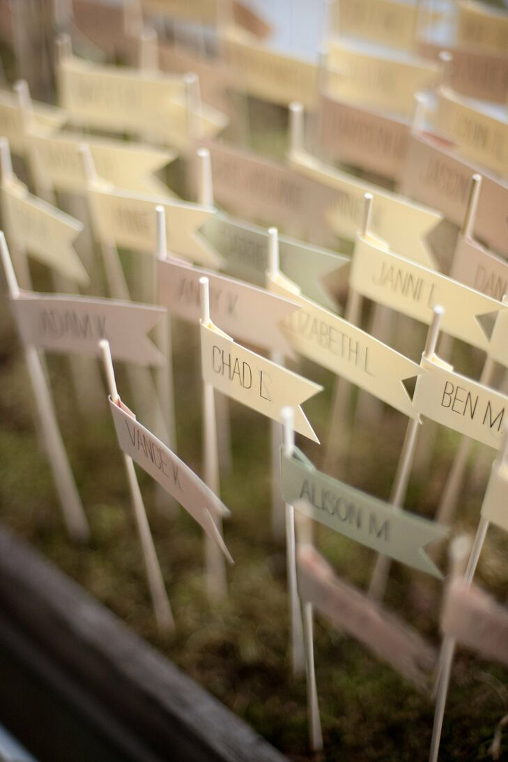 The couple placed their small, pennant-style escort cards in a bed of moss at the entrance to the reception area.
