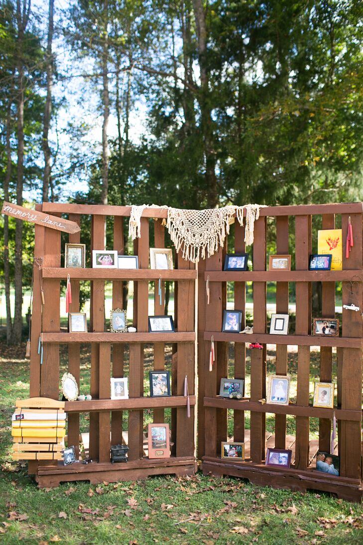 "The bride's father and grandfather built ""pallet walls"" to display family photos and heirlooms during the rustic reception."