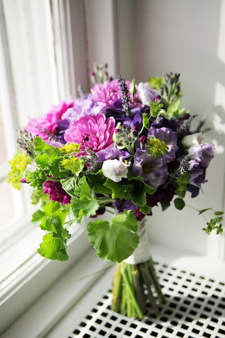 Kate carried a bouquet with chrysanthemums, lavender and greens. Floral design at her wedding was provided by Occasional Flowers.