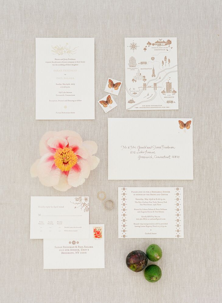 Loose bouquet illustrations and butterflies accented Sarah and Paul's cooper and gold invitations.