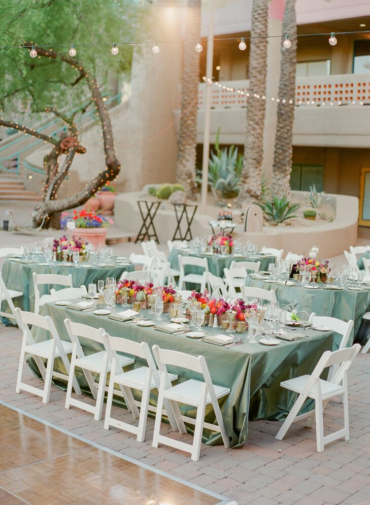 """""""Since our flowers were bold and colorful, I loved the idea of a neutral green contrasted against all the color we had naturally in our floral pieces for our tables and linens. We chose a shimmer thyme for the tables and a moss green napkin. It looked gorgeous,"""" she says."""