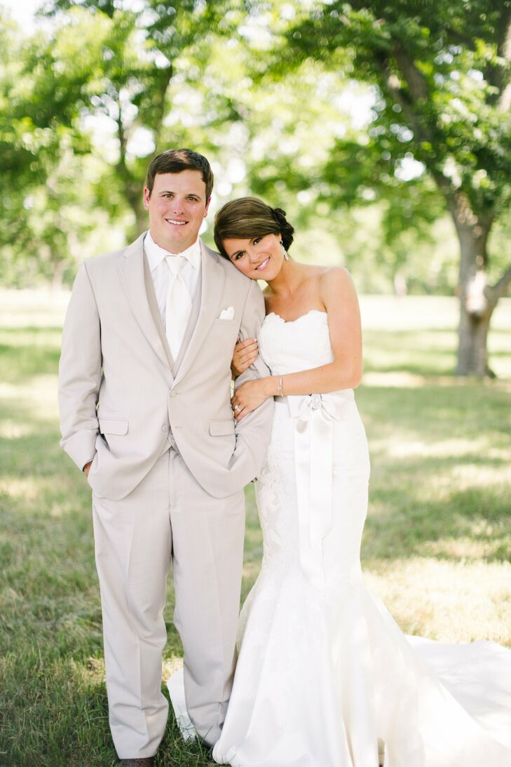 Kayla's ivory alencon lace and silk shantung gown was named Poppy Trumpet. It was custom-tailored for me by Matthew Christopher dropping the back into a deep V with buttons extending the length of the chapel train. It wasn't what I had planned, but it was perfect! she says.
