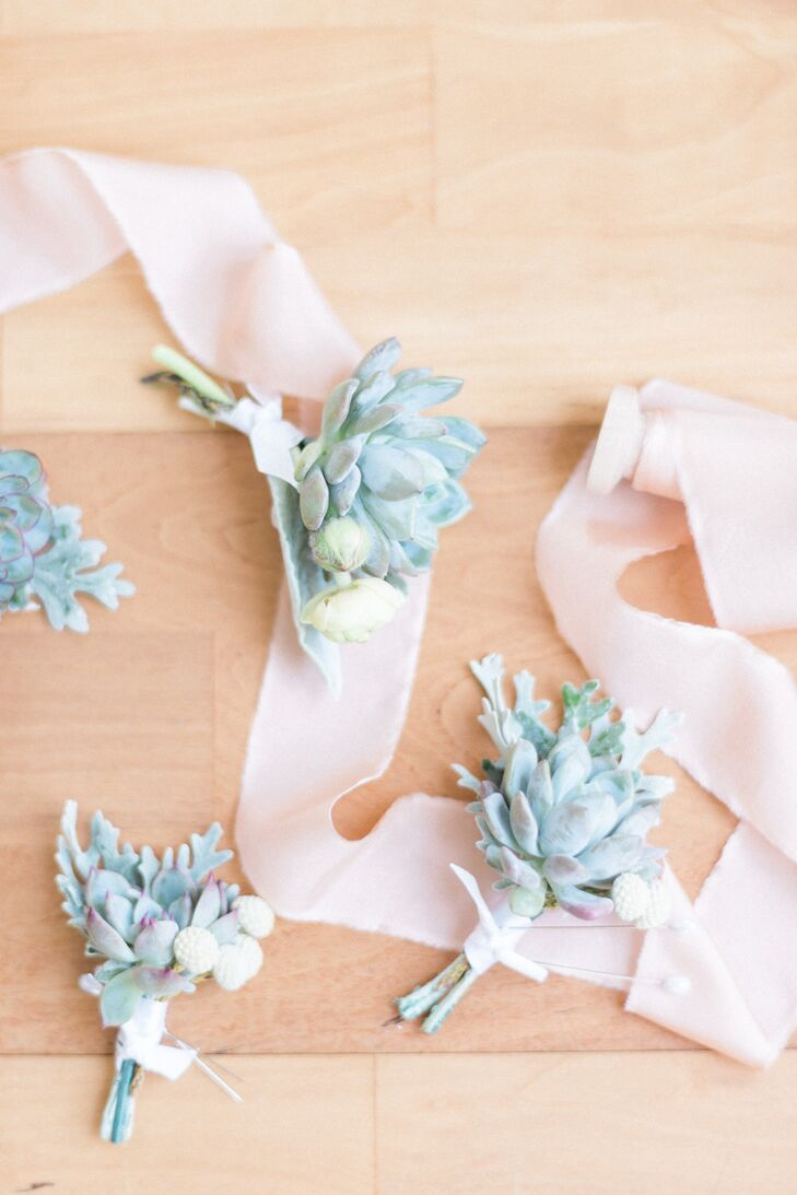 While the bouquet designs were left up to the pros at Isn't She Lovely Florals, Stephanie and Dallas had a specific vision for the boutonniere: They wanted succulents. Each man in the wedding party wore a small arrangement of succulents, dusty miller and silver brunia on his lapel.