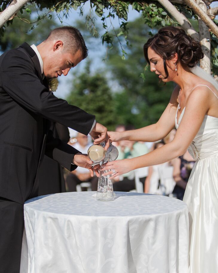 The couple performed a sand pouring ceremony during their nuptials.