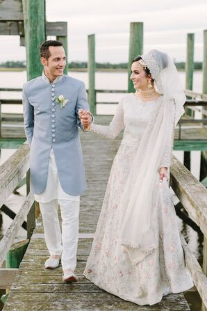 Traditional, Elegant Muslim Couple with White Lehenga Choli and Blue Sherwani