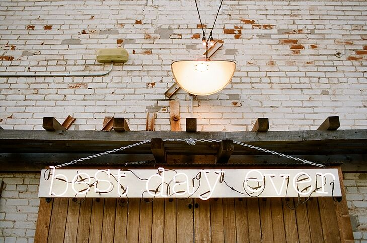 "An illuminated hanging ""Best Day Ever"" sign added to the wedding day feel."