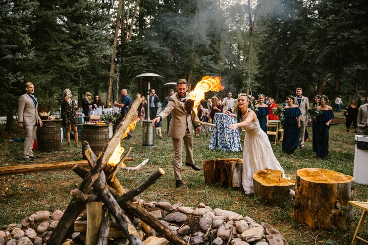Rustic Couple Lighting Bonfire as Unity Ceremony