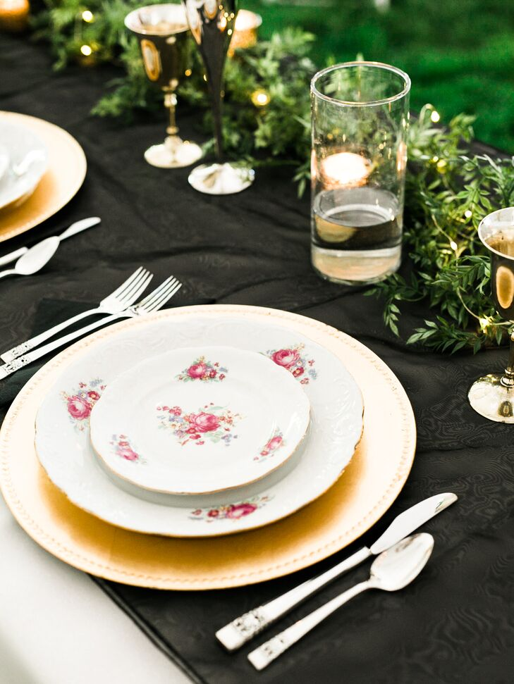 Kassi topped each table with black linens and used her grandparents' wedding china beside gold chargers.