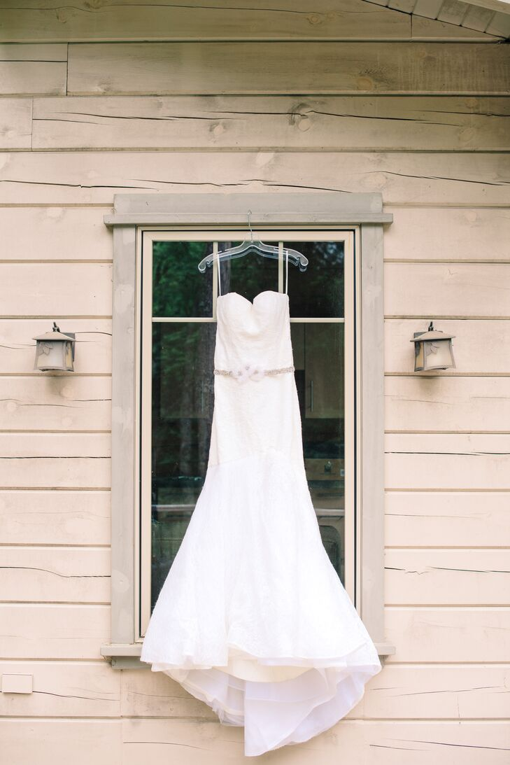 """""""I wanted to stick to a simple yet elegant look for my wedding day, since it's more in line with my everyday style,"""" Nancy says of her Rivini wedding gown. The romantic lace overlay gave the look a romantic feel, while the gown's mermaid-style silhouette was the picture of modern elegance."""